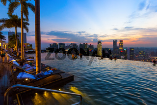 SINGAPORE - APRIL 14: Pool on roof and Singapore city skyline on April 14, 2016 in Singapore