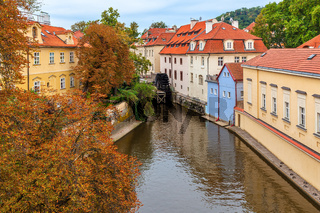 Narrow canal and colorful houses in Prague.