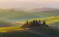 Farmhouse in a tuscany landscape at sunrise