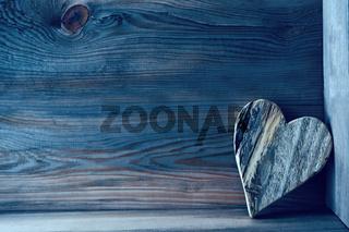 Wooden heart on shelf