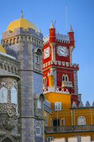 Pena castle red clock tower and blue mosaic towers in Sintra