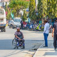 Nepali man in wheelchair in Pokhara