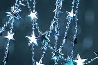 Christmas stars on sparkles background