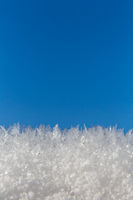 Ice needles in front of blue sky