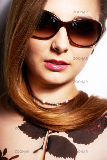 Young female with sunglasses