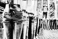 Mannequins, dressed in jeans, standing one behind