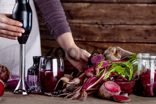 Making a beetroots juice with blender