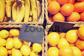 fruits in baskets with nameplates at food market