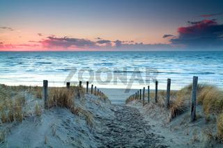 sunset over North sea sand beach