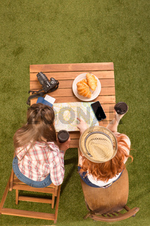 Ladies sitting at table in park