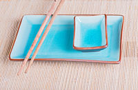 View to bamboo mat, dish and chopsticks