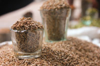 cumin seeds in glass at local market, indian spices