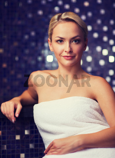beautiful young woman sitting in bath towel