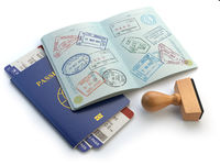 Opened passport with visa stamps and airline boading pass tickets isolated on white. Travel or turism concept.