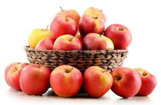 Apples in wicker basket isolated on white background
