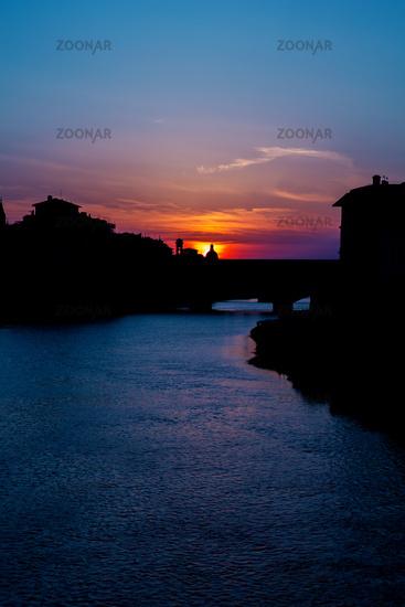 Sundown behind ponte vecchio in florence tuscany