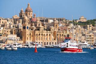 The ship  passes the bay along the Birgu coast, Malta.