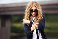 Fashion business woman calling on mobile phone