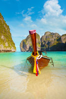 Traditional Longtail Boat Tied to a Tropical Beach in Thailand