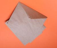 Brown envelops on orange background