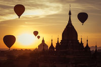 Hot air balloons flying over Buddhist Temples at Bagan. Myanmar