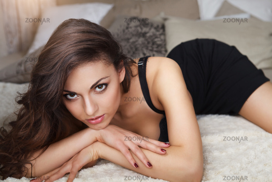 Beautiful sexy young brunette woman wearing black lingerie