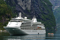 Cruise ship Silver Whisper and feeder boat in the Geirangerfjord, Geiranger, Norway