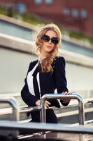 Young fashion business woman in sunglasses