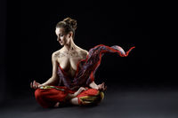 Yoga. Sensual woman meditating in lotus position