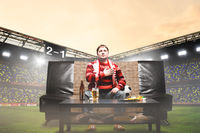 football fan on sofa at stadium