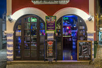 Night shot of a trendy pub in the City. Lagos, Algarve, Portugal.