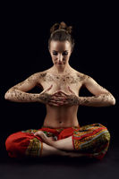 Yoga. Woman#39;s body covered with floral patterns