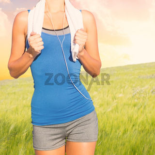 Composite image of fit woman with towel
