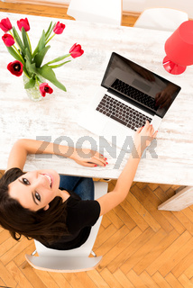 Young beautiful woman using a Laptop at home
