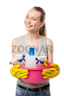 Smiling young woman with cleansers isolated