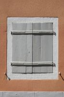 Shutters of an old townhouse in the center of Staufen