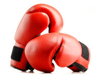 Pair of red leather boxing gloves isolated on white background
