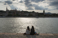Women sitting at river Danube, Budapest, Hungary
