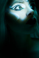 Beautiful Woman with frozen makeup in dark