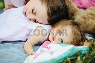 Young beautiful woman with her child outdoors
