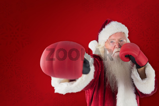 Composite image of santa claus punches with his right