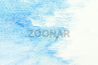 Blue watercolor paint on canvas. Abstract art background.