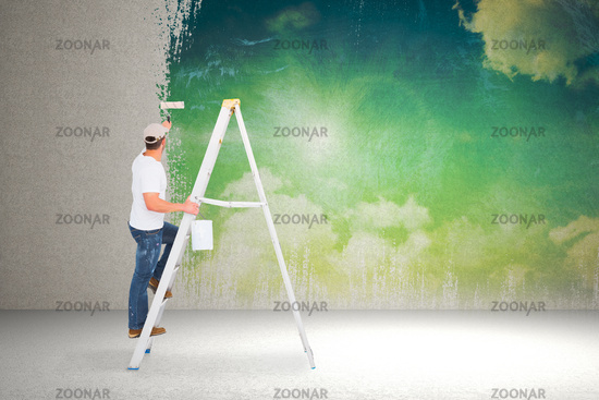 Composite image of handyman climbing ladder while using paint roller