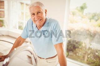 Senior man standing and looking at the camera