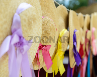 Straw hats with ribbons