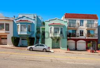 Colorful houses on sloping street in San Francisco.