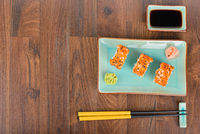 Sushi rolls on the wooden table. Overhead view