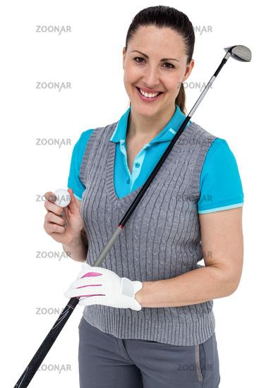 Golf player holding a golf club and golf ball