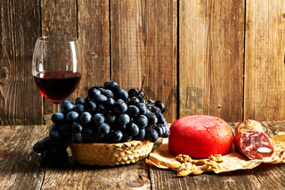 Grapes, cheese and red wine