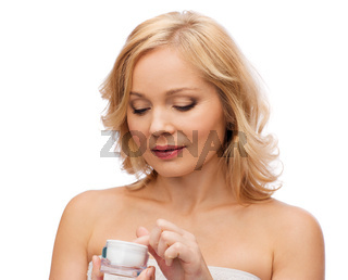 middle aged woman with cream jar